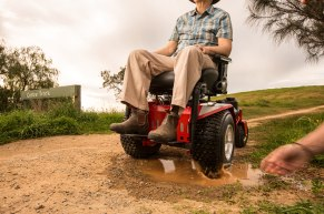Driving the wheelchair to make a puddle would be difficult - so make your own splash by throwing rocks